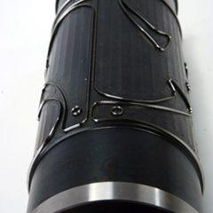 Cylindre gravé noir très zoomé